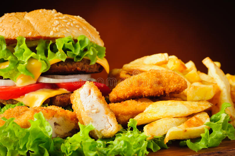 Fast food. Menu with chicken nuggets, hamburger and french fries stock image