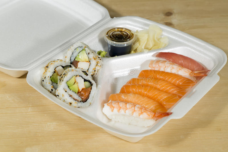 Fast Food Sushi. In its box on wooden table stock photo