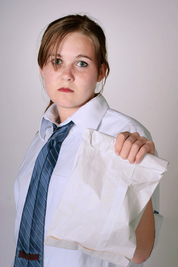 Fast food worker. Young woman holds a bag of fast food royalty free stock image