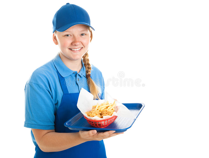 Fast Food Worker - Teenager. Teenage fast food worker holding a tray of chicken nuggets and fries. Isolated on white stock photography