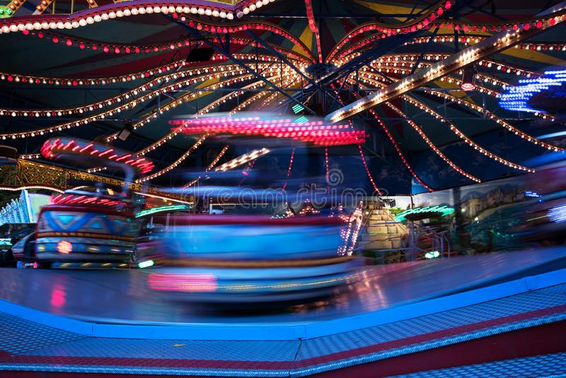 Fast funfair ride carousel at the christmas market, long exposu royalty free stock photo