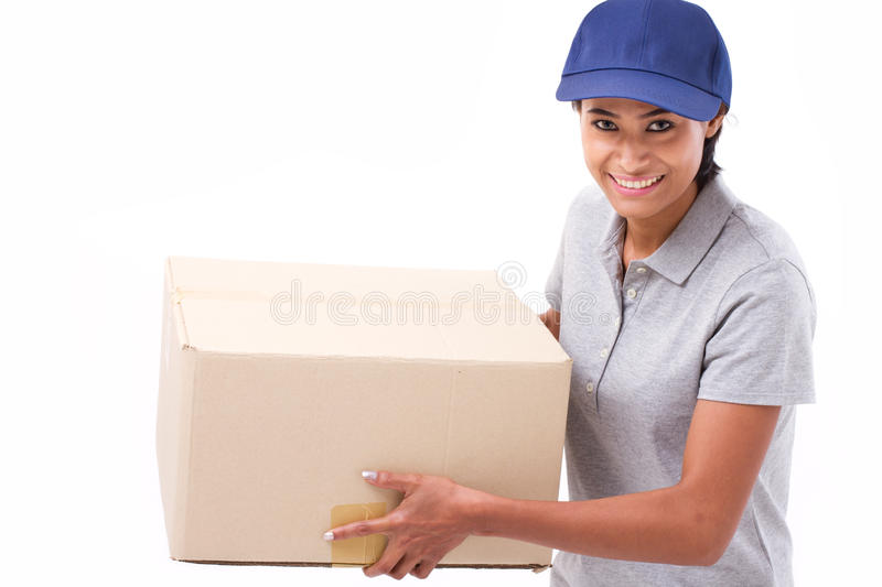 Fast, happy, female delivery service staff with parcel or carton stock image