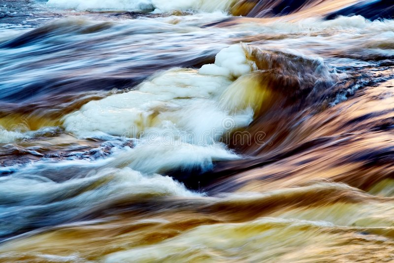 Fast icy river. With blurred water in motion stock photography