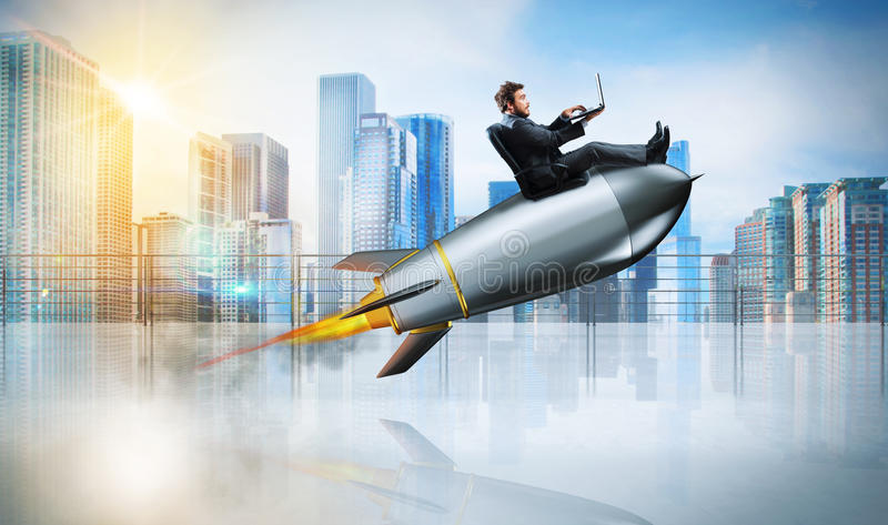 Fast internet concept with a businessman with laptop over a rocket. Fast internet concept with a businessman with laptop over a speedy rocket royalty free stock photos