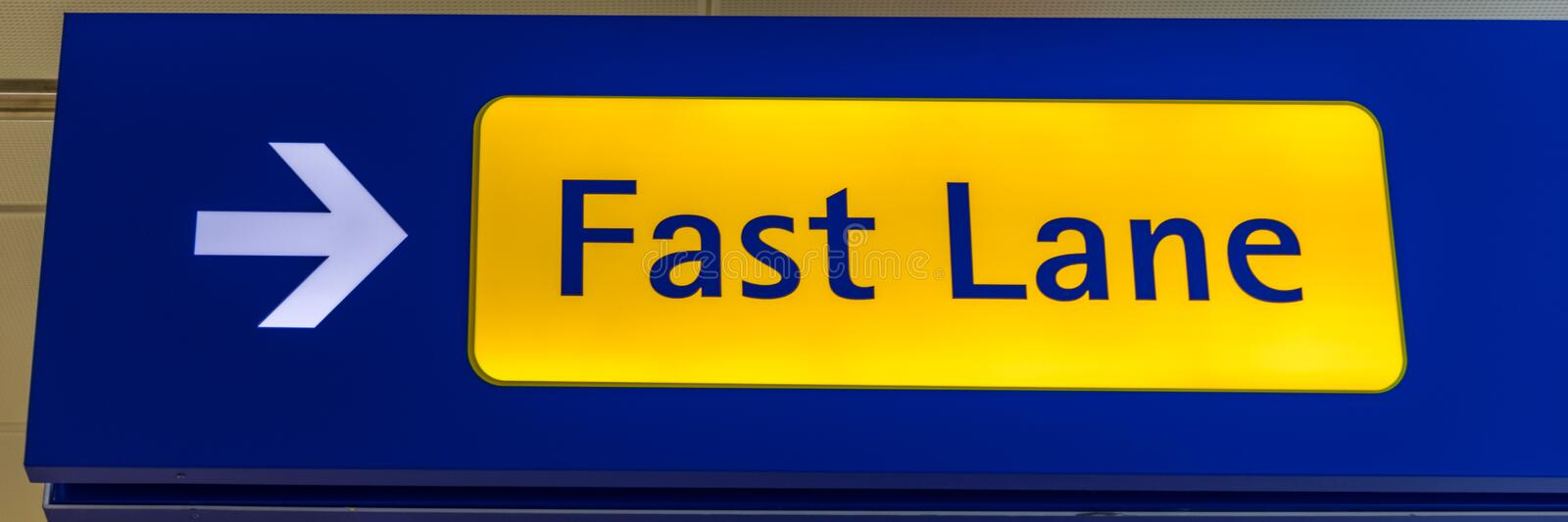 Fast Lane sign in blue and yellow at the airport close up. Fast Lane sign airport first class luxury notification.  royalty free stock photography