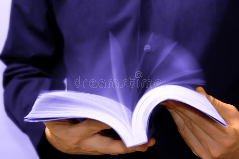 Fast learning: man reading book in motion royalty free stock photography