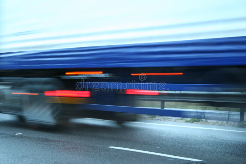 Fast Lorry. Abstract blurred lorry on wet road