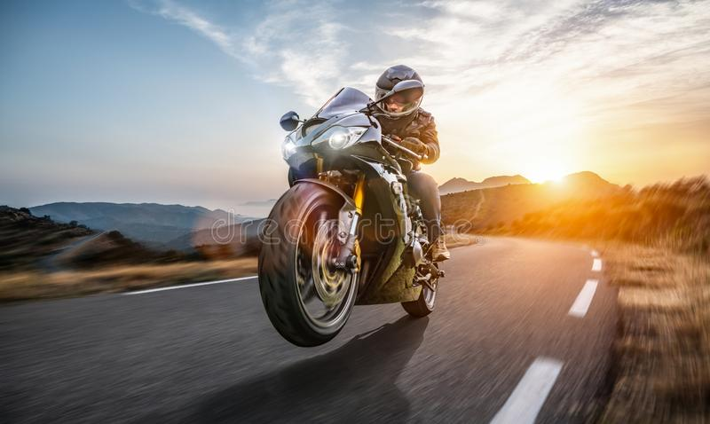 Fast motorbike on the coastal road riding. having fun driving the empty highway on a motorcycle tour journey stock photography