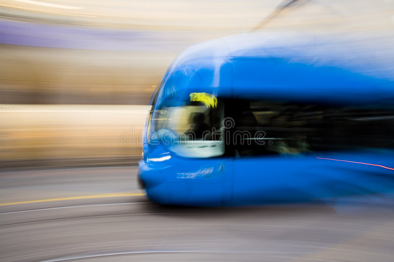 Fast moving blue tramway stock photography