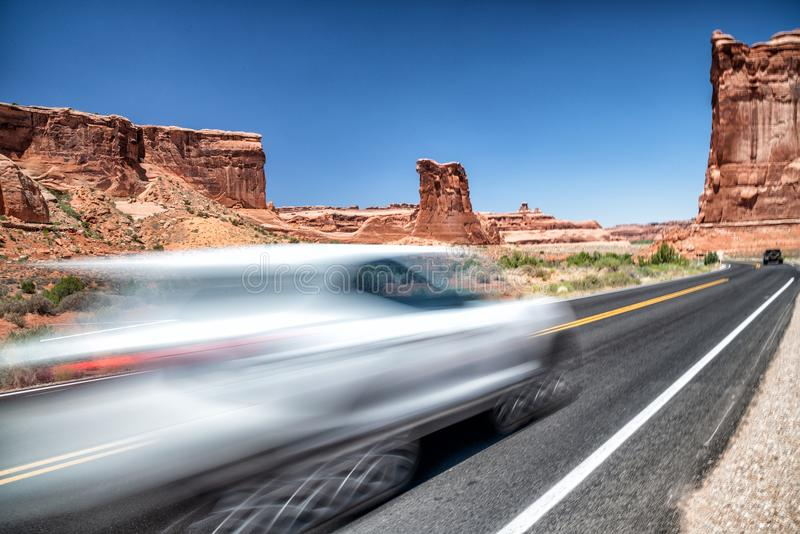 Fast moving car entering Arches National Park, Utah - USA.  stock image