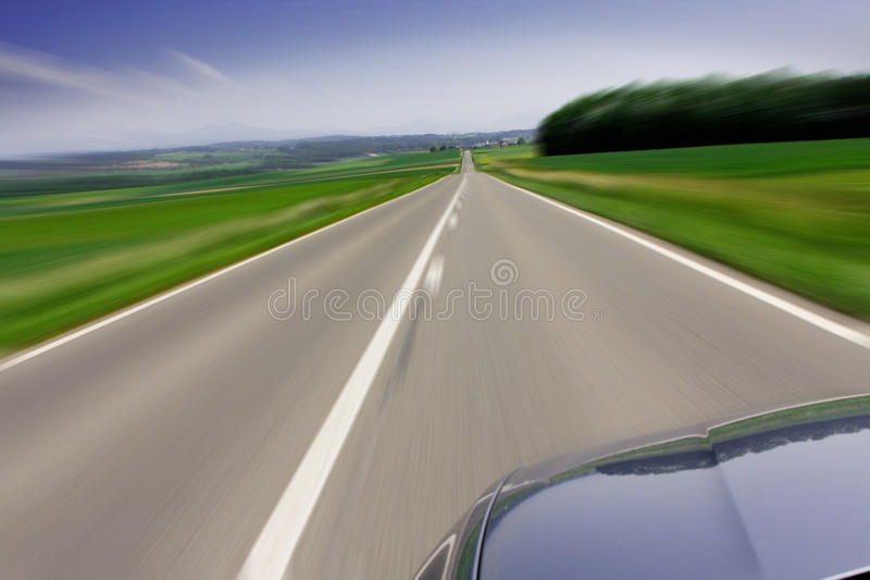 Fast moving car on road stock image