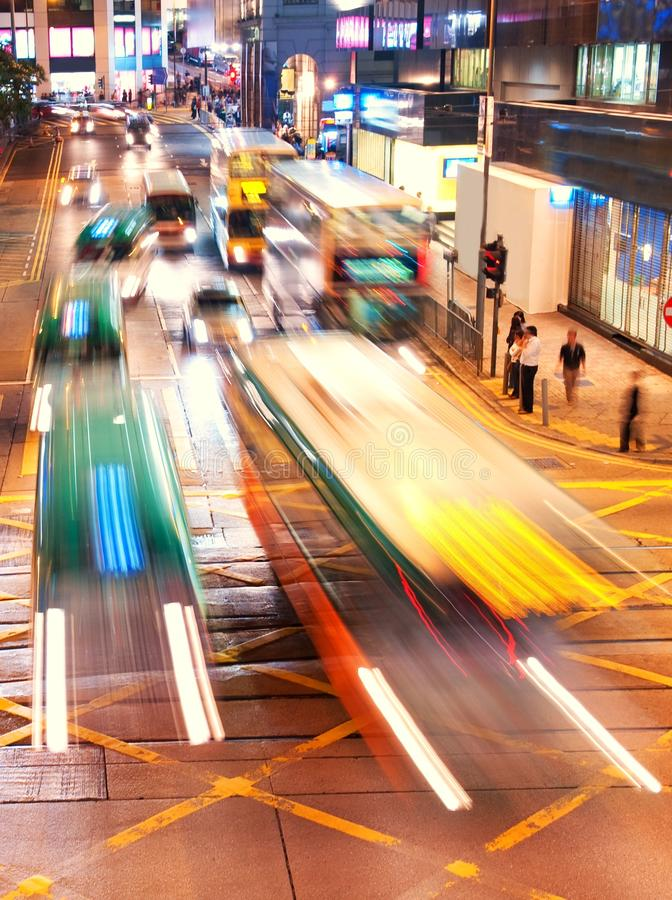 Fast moving cars at night time royalty free stock images