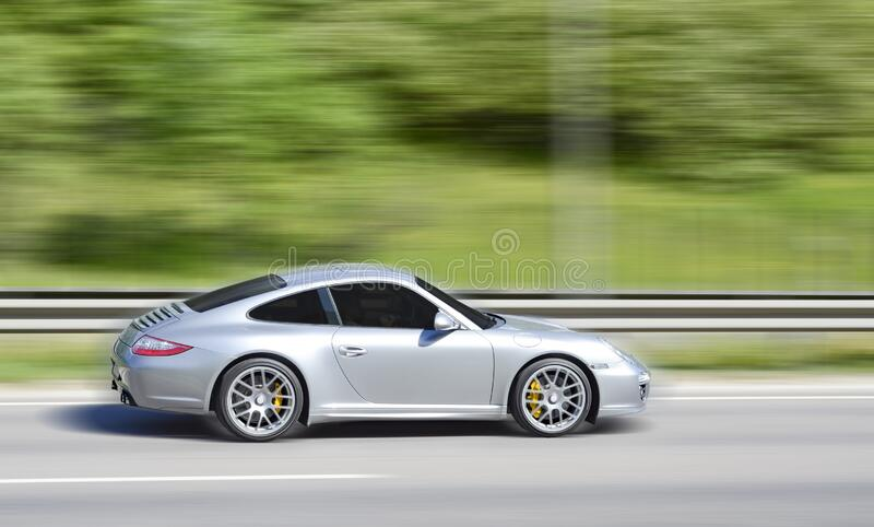 Fast moving high performance sports car royalty free stock photo