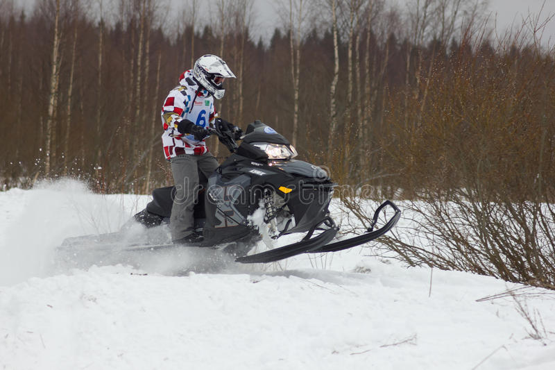 Fast moving snowmobile rider stock photo