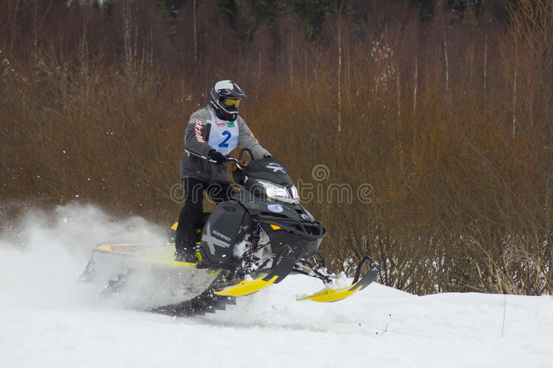 Fast moving snowmobile rider royalty free stock image