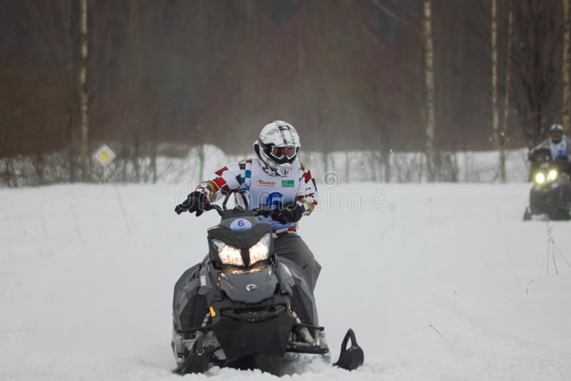Fast moving snowmobile rider royalty free stock photo