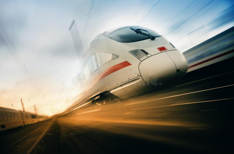 Fast moving train. On an urban railroad stock photography