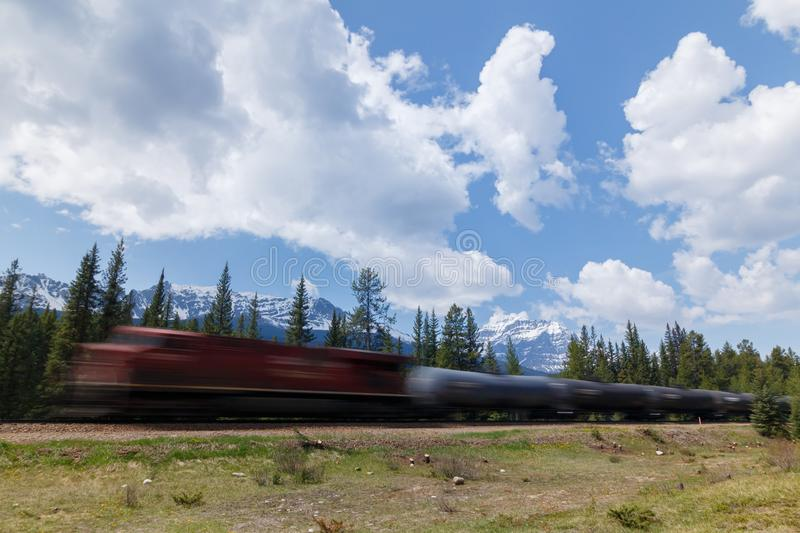 Fast moving train with mountain landscape background stock images