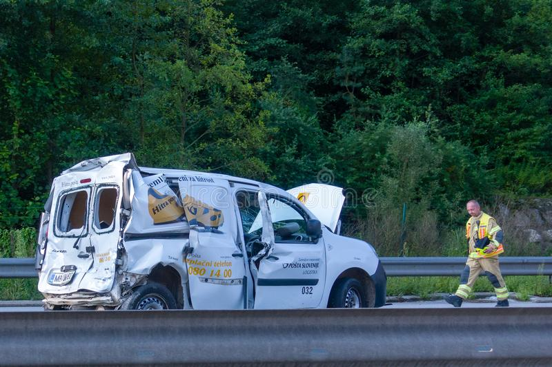 Fast Parcel Delivery Van of Slovenian Post wrecked in car crash on Styrian Highway A1 near Blagovica, Fireman walking stock photography