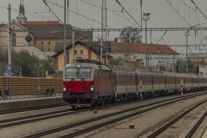 Fast passenger train with red modern electric engine in Ilava station. In west Slovakia, building, business, castle, cloudy, cold, dark, day, dusk, europe stock images