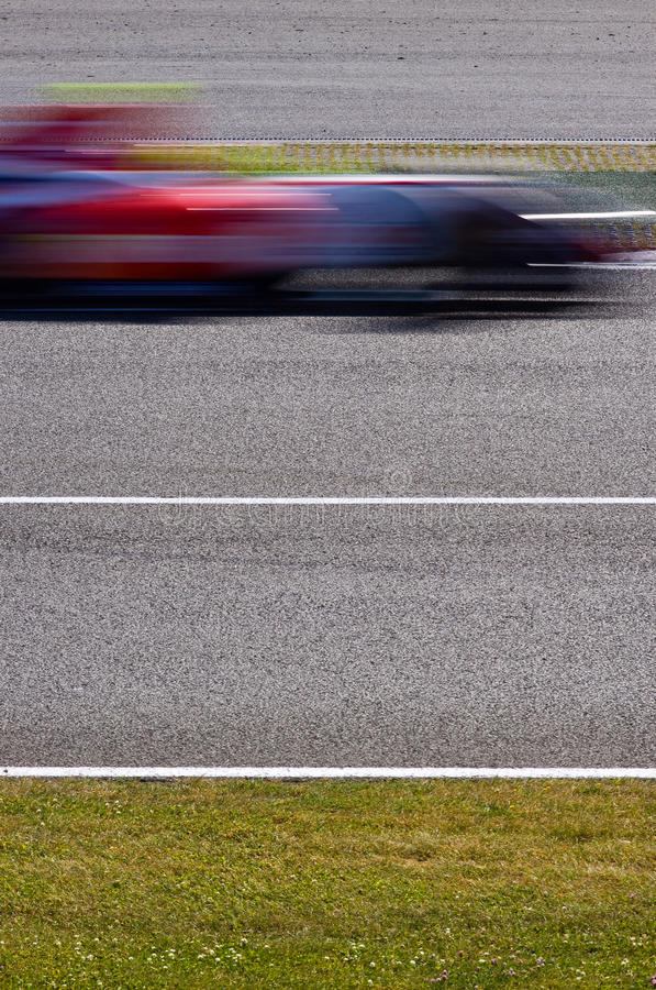 Fast racing car blur stock photography