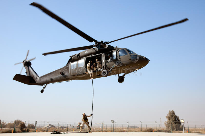 Fast rope from a Blackhawk royalty free stock photography