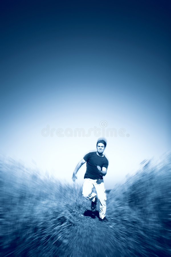 Fast running man blue tint. Fast running man. Saturated blue tint stock photos