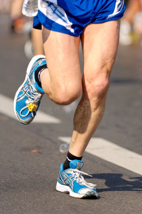 Fast running shoes. A runner at the berlin half marathon royalty free stock images