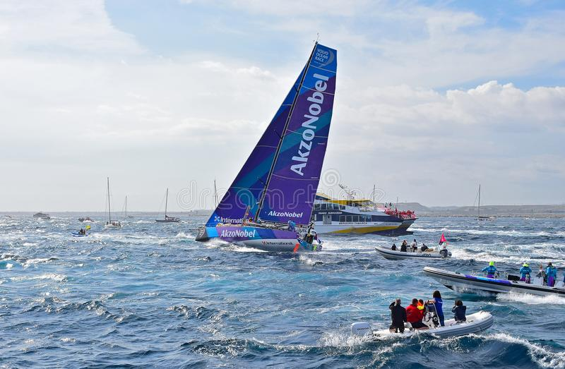 Leaning Over Team AkzoNobel Passes A Navy Ship Volvo Ocean Race Alicante stock photography