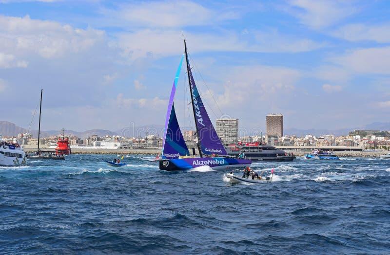 A Rib Following Team AkzoNobel Passes A Navy Ship Volvo Ocean Race Alicante stock photos