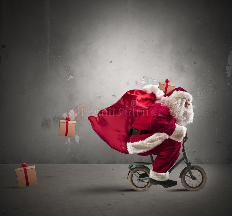 Fast Santa Claus on the bike stock images