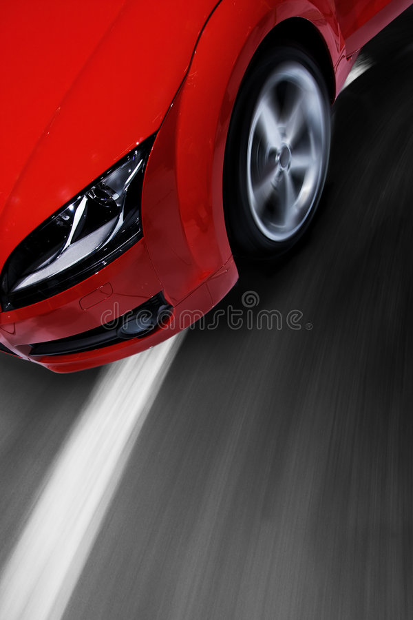 Fast sports car moving with blur. Fast sports car moving with motion blur and zooming effect royalty free stock photos