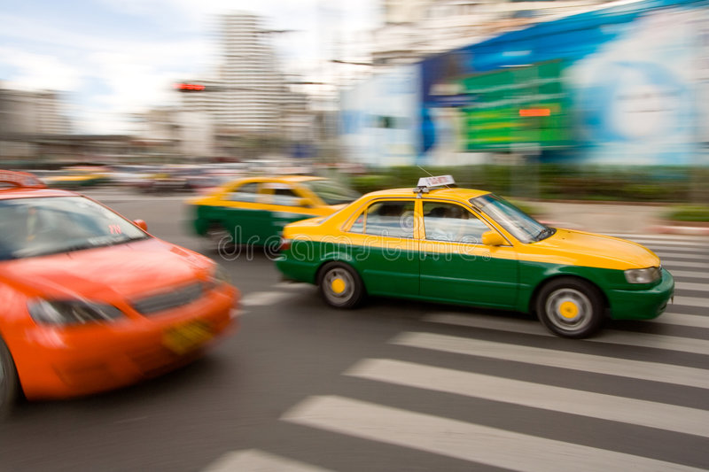Fast taxi in city traffic stock photo