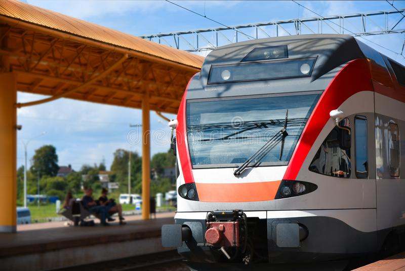 A fast train arrives at the train station royalty free stock photo