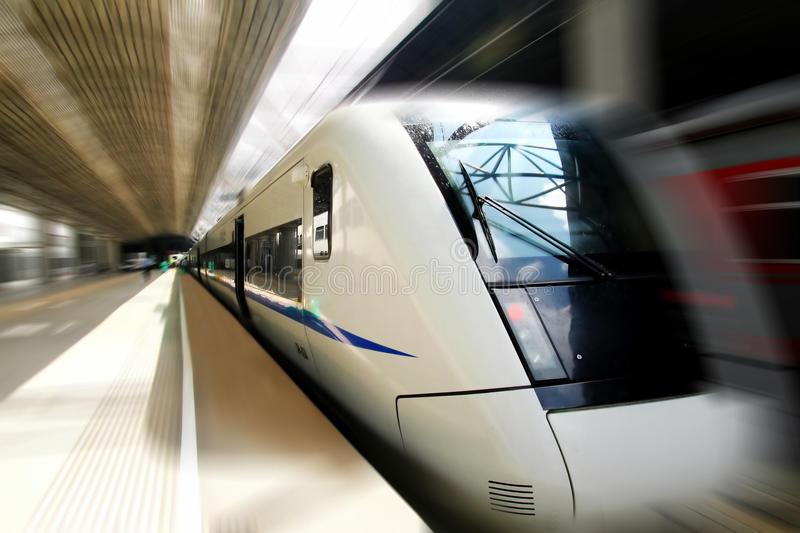Fast train in motion. Fast train with motion blur in China royalty free stock photography