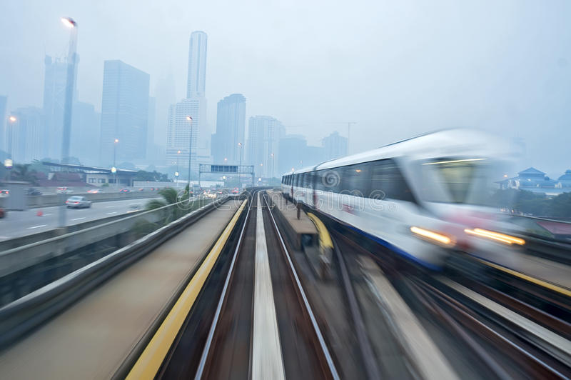 Fast Train. Passing by during hazy in the morning stock photo