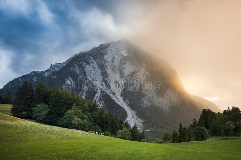 Upcoming Rain in the Alps at Sunset royalty free stock photo