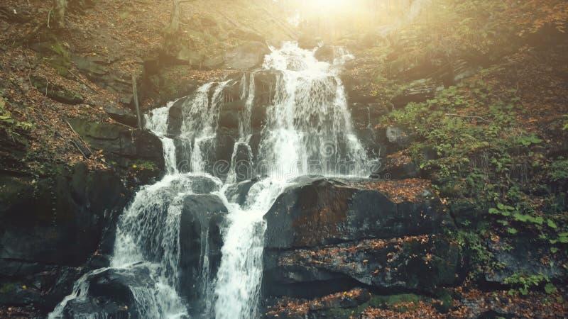 Fast wild nature highland stream flow stony ground stock image
