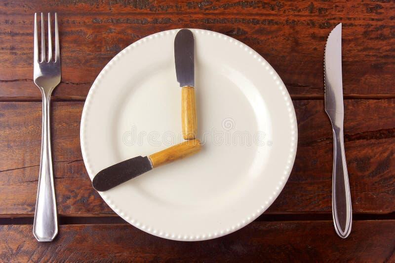 Fastan är en metod för viktförlust vars mål är att göra kroppen att använda den feta diversehandeln royaltyfri fotografi