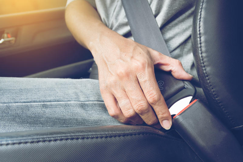 Fasten the car seat belt. Safety belt safety first royalty free stock photography
