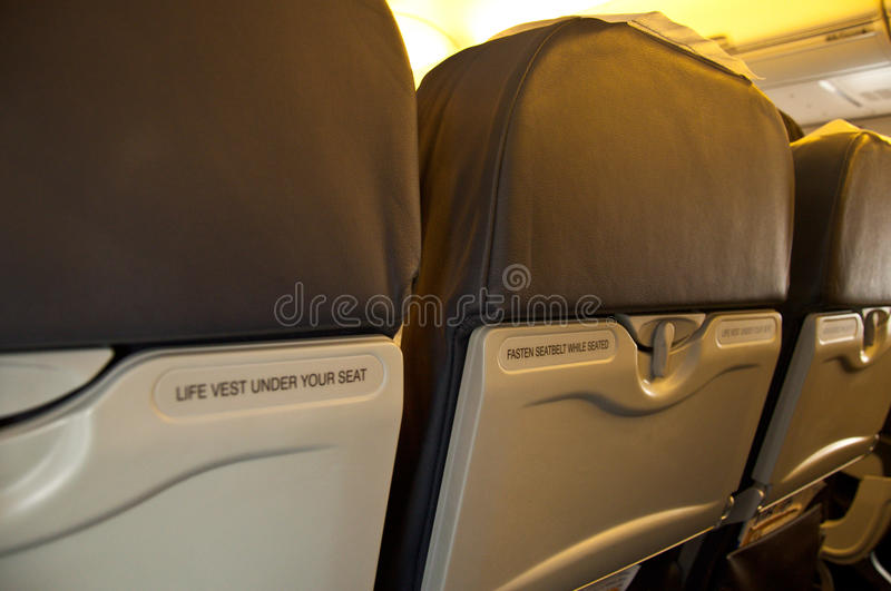 Download Fasten Seat Belt Sign On The Back Of A Seat From A Airplane Stock Image - Image: 32651185
