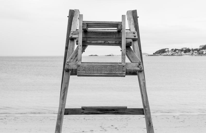 Fasten your seat belts. Lifegard sea in Coroso. Lifegard seat in Coroso beach in Riveira, Galicia Spain. Black and white royalty free stock images