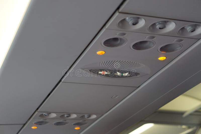 fasten your seat belts and no smoking sign at air condition aircraft interior royalty free stock photography