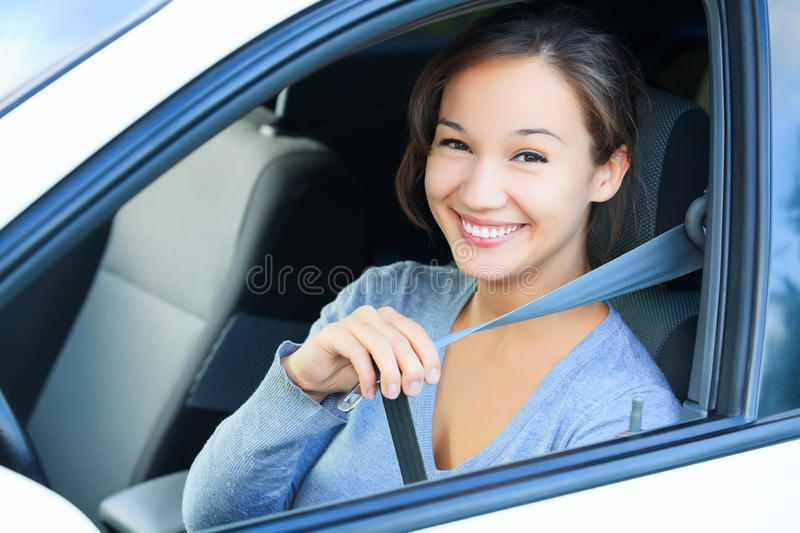 Fasten your seatbelt. For your safety always fasten your seatbelt. Girl in a car royalty free stock photography