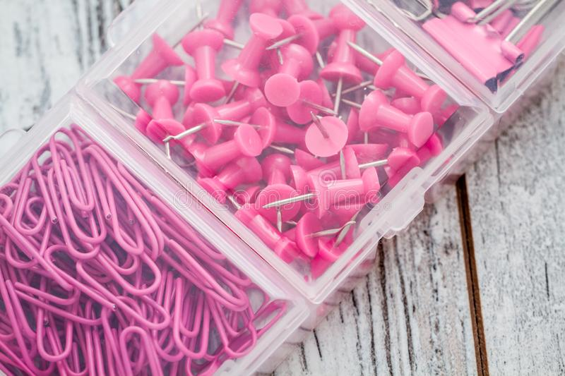 Fasteners, Pins and Clips in Small Transparent Plastic Box royalty free stock image