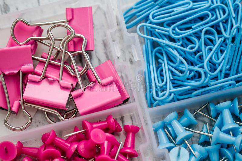 Fasteners, Pins and Clips in Small Transparent Plastic Box stock photo