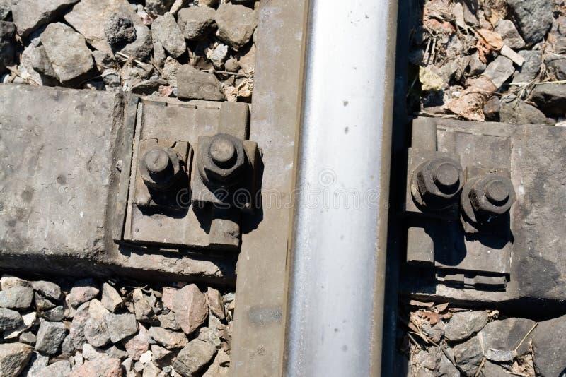 Fastening rails to the crosstie. The railway. Fastening rails to the crosstie close up stock photography