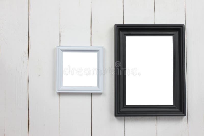 Fastställd träbildram av mellanrumet på det vita trägolvet arkivfoton