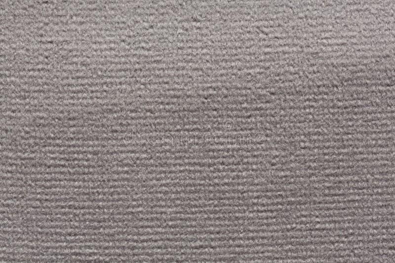 Faszinierender Textilhintergrund im hellgrauen Ton lizenzfreie stockbilder