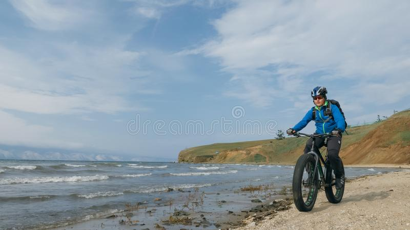 Fat bike also called fatbike or fat-tire bike in summer driving on the beach. stock photos